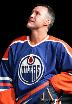 EDMONTON, CANADA - OCTOBER 18:  Edmonton Oiler great Paul Coffey fights back tears as he watches his number 7 retirement banner being raised to the rafters during a special ceremony on October 18, 2005 at Rexall Place in Edmonton, Alberta, Canada.  (Photo