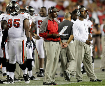 TAMPA, FL - AUGUST 28:  Head coach Raheem Morris of the Tampa Bay Buccaneers looks over his play sheet against the Jacksonville Jaguars during a preseason game at Raymond James Stadium on August 28, 2010 in Tampa, Florida.  (Photo by J. Meric/Getty Images