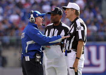 EAST RUTHERFORD, NJ - OCTOBER 17:  Head coach  of the New York Giants, Tom Coughlin talks to referee Jeff Triplette #42 against the Detroit Lions at New Meadowlands Stadium on October 17, 2010 in East Rutherford, New Jersey.  (Photo by Nick Laham/Getty Im