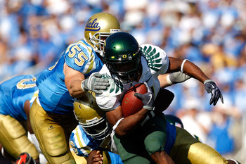 PASADENA, CA. - OCTOBER 10:  Kenjon Barner #24 of the Oregon Ducks runs the ball in the Fourth Quarter as Korey Bosworth #55 tackles him on October 10, 2009 at the Rosebowl in Pasadena, California.  (Photo by Jacob De golish/Getty Images)