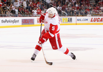 GLENDALE, AZ - OCTOBER 16:  Nicklas Lidstrom #5 of the Detroit Red Wings shoots the puck during the NHL game against the Phoenix Coyotes at Jobing.com Arena on October16, 2010 in Glendale, Arizona.  The Red Wings defeated the Coyotes 2-1 in overtime.  (Ph
