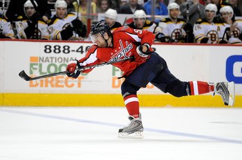 WASHINGTON - APRIL 11:  Mike Green #52 of the Washington Capitals shoots the puck against the Boston Bruins at the Verizon Center on April 11, 2010 in Washington, DC.  (Photo by Greg Fiume/Getty Images)