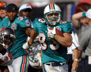 Miami Dolphins wide receiver  Wes Welker rushes upfield on a kick return against the Tampa Bay Buccaneers October 16, 2005 in Tampa.  The Bucs defeated the Dolphins  27-13.  (Photo by Al Messerschmidt/Getty Images)