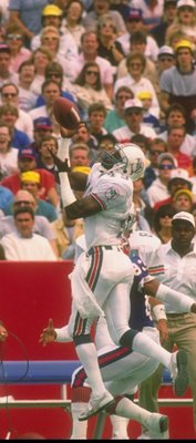 11 Sep 1988:  Defensive back William Judson of the Miami Dolphins goes up for the ball during a game against the Buffalo Bills at Joe Robbie Stadium in Miami, Florida.  The Bills won the game, 9-6. Mandatory Credit: Rick Stewart  /Allsport