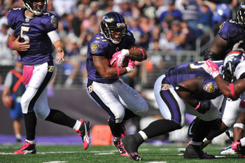 BALTIMORE, MD - OCTOBER 10: Ray Rice #27 of the Baltimore Ravens runs the ball against the Denver Broncos at M&T Bank Stadium on October 10, 2010 in Baltimore, Maryland. Players wore pink in recognition of Breast Cancer Awareness Month. The Ravens defeate