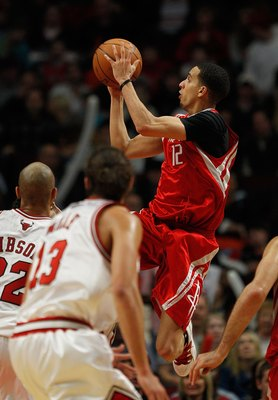 CHICAGO - MARCH 22: Kevin Martin #12 of the Houston Rockets puts up a shot over Taj Gibson #22 of the Chicago Bulls at the United Center on March 22, 2010 in Chicago, Illinois. The Bulls defeated the Rockets 98-88. NOTE TO USER: User expressly acknowledge