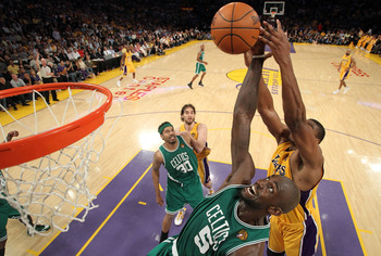 LOS ANGELES, CA - JUNE 17:  Kevin Garnett #5 of the Boston Celtics goes up for the ball in front of Andrew Bynum #17 of the Los Angeles Lakers in Game Seven of the 2010 NBA Finals at Staples Center on June 17, 2010 in Los Angeles, California.  NOTE TO USE