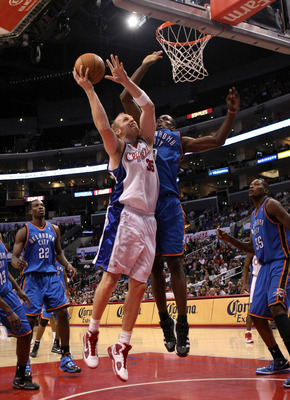 LOS ANGELES, CA - NOVEMBER 11:  Chris Kaman #35 of the Los Angeles Clippers shoots over Serge Ibaka #9 of the Oklahoma City Thunder on November 11, 2009 at Staples Center in Los Angeles, California.  The Thunder won 83-79.   NOTE TO USER: User expressly a