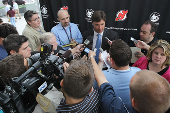 NEWARK, NJ - JULY 20: Ilya Kovalchuk of the New Jersey Devils speaks with the media after announcing his contract renewal at the Prudential Center on July 20, 2010 in Newark, New Jersey. (Photo by Bruce Bennett/Getty Images)