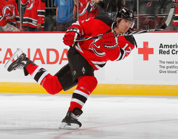 NEWARK, NJ - SEPTEMBER 25:  Brian Rolston #12 of the New Jersey Devils during  warmups before a preseason hockey game against the New York Rangers at the Prudential Center on September 25, 2010 in Newark, New Jersey.  (Photo by Paul Bereswill/Getty Images