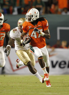 MIAMI, FL - OCTOBER 9: LaRon Byrd #47 of the Miami Hurricanes runs with the ball while being chased by Nick Moody #10 of the Florida State Seminoles on October 9, 2010 at Sun Life Stadium in Miami, Florida. The Seminoles defeated the Hurricanes 45-17. (Ph