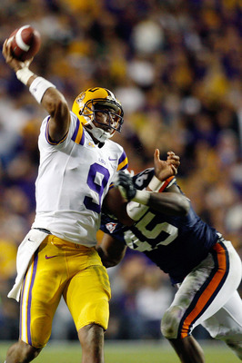 BATON ROUGE, LA - OCTOBER 24:  Jordan Jefferson #9 of the Louisiana State University Tigers is tackled as he throws the ball by Antoine Carter #45 of the Auburn Tigers at Tiger Stadium on October 24, 2009 in Baton Rouge, Louisiana.  (Photo by Chris Grayth