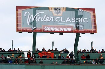 BOSTON - JANUARY 01:  Fans watch the game between the Philadelphia Flyers and the Boston Bruins during the 2010 Bridgestone Winter Classic at Fenway Park on January 1, 2010 in Boston, Massachusetts.  The Boston Bruins defeated the Philadelphia Flyers 2-1