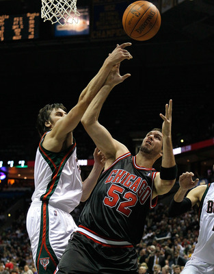 MILWAUKEE - NOVEMBER 30: Brad Miller #52 of the Chicago Bulls battles for a rebound with Andrew Bogut #6 of the Milwaukee Bucks at the Bradley Center on November 30, 2009 in Milwaukee, Wisconsin. The Bucks defeated the Bulls 99-97. NOTE TO USER: User expr