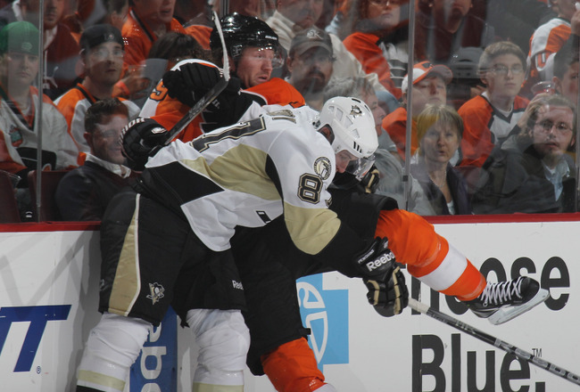 PHILADELPHIA - OCTOBER 16: Sidney Crosby #87 of the Pittsburgh Penguins hits Scott Hartnell #19 of the Philadelphia Flyers at the Wells Fargo Center on October 16, 2010 in Philadelphia, Pennsylvania.  (Photo by Bruce Bennett/Getty Images)