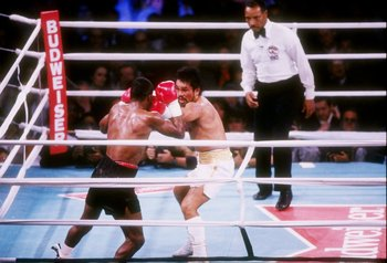 DEC 1989:  Roberto Duran (right) trades blows with Sugar Ray Leonard during their fight at The Mirage Hotel in Las Vegas, Nevada.