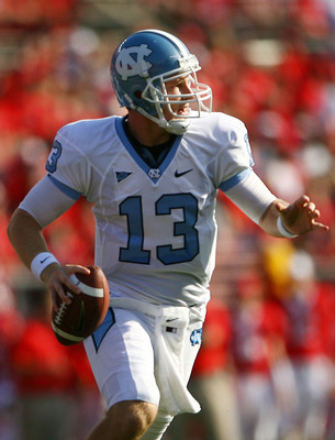 NEW BRUNSWICK, NJ - SEPTEMBER 25:  T.J. Yates #13 of the North Carolina Tar Heels drops back against the Rutgers Scarlet Knights at Rutgers Stadium on September 25, 2010 in New Brunswick, New Jersey.  (Photo by Andrew Burton/Getty Images)