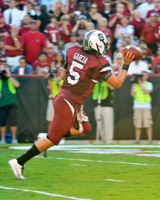 COLUMBIA, SC - OCTOBER 9: Quarterback Stephen Garcia #5 of the South Carolina Gamecocks tosses the football out of the end zone to avoid a sack after a botched snap against the Alabama Crimson Tide October 9, 2010 at Williams-Brice Stadium in Columbia, So