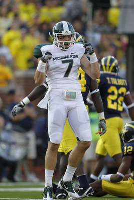 ANN ARBOR, MI - OCTOBER 09: Steve Nichol #7 of the Michigan State Spartans celebrates a 42 yard pass compleation from Kirk Cousins #8 during the third quarter of the game against the Michigan Wolverines on October 9, 2010 at Michigan Stadium in Ann Arbor,