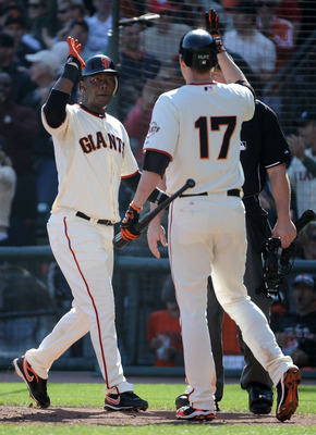 SAN FRANCISCO - OCTOBER 19:  Edgar Renteria #16 of the San Francisco Giants celebrates scoring against the Philadelphia Phillies with Aubrey Huff #17 in the fourth inning of Game Three of the NLCS during the 2010 MLB Playoffs at AT&T Park on October 19, 2