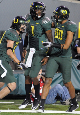 EUGENE, OR - OCTOBER 2: Wide receiver Jeff Maehl #23, quarterback Darron Thomas #1 and wide receiver Lavasier Tuinei #80 of the Oregon Ducks celebrate after Thomas scored a touchdown in the third quarter of the game against the Stanford Cardinal at Autzen