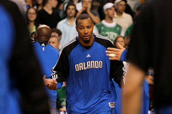 BOSTON - MAY 22:  Rashard Lewis #9 of the Orlando Magic greets his teammates during player introducitons against the Boston Celtics at TD Banknorth Garden in Game Three of the Eastern Conference Finals during the 2010 NBA Playoffs on May 22, 2010 in Bosto