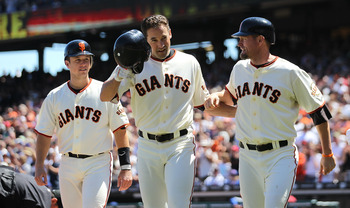 SAN FRANCISCO - AUGUST 12:  Pat Burrell #9 of the San Francisco Giants celebrates with Buster Posey #28 and Aubrey Huff #17 after hitting a grand slam against the Chicago Cubs in the fifth inning during an MLB game at AT&T Park on August 12, 2010 in San F