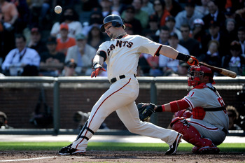 SAN FRANCISCO - OCTOBER 19:  Aaron Rowand #33 of the San Francisco Giants fouls the ball off in the third inning against the Philadelphia Phillies in Game Three of the NLCS during the 2010 MLB Playoffs at AT&T Park on October 19, 2010 in San Francisco, Ca