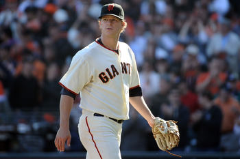SAN FRANCISCO - OCTOBER 19:  Matt Cain #18 of the San Francisco Giants walks off the field in the middle of the seventh inning against the Philadelphia Phillies in Game Three of the NLCS during the 2010 MLB Playoffs at AT&T Park on October 19, 2010 in San
