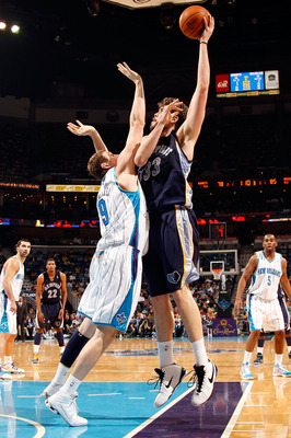 NEW ORLEANS - JANUARY 20:  Marc Gasol #33 of the Memphis Grizzlies shoots the ball over Darius Songaila #9 of the New Orleans Hornets at the New Orleans Arena on January 20, 2010 in New Orleans, Louisiana.  The Hornets defeated the Grizzlies 113-111.  NOT