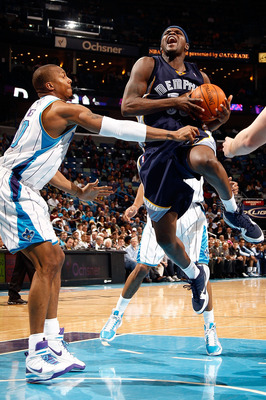 NEW ORLEANS - MARCH 03:  Zach Randolph #50 of the Memphis Grizzlies is fouled by David West #30 of the New Orleans Hornets at the New Orleans Arena on March 3, 2010 in New Orleans, Louisiana.  The Grizzlies defeated the Hornets 104-100.  NOTE TO USER: Use