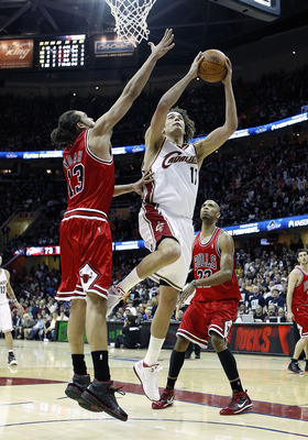 CLEVELAND - APRIL 17:  Anderson Varejao #17 of the Cleveland Cavaliers gets to the basket between Joakim Noah #13 and Taj Gibson #22 of the Chicago Bulls in Game One of the Eastern Conference Quarterfinals during the 2010 NBA Playoffs at Quicken Loans Are