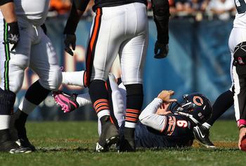 CHICAGO - OCTOBER 17: Jay Cutler #6 of the Chicago Bears lays on the ground after being sacked by the Seattle Seahawks at Soldier Field on October 17, 2010 in Chicago, Illinois. The Seahawks defeated the Bears 23-20. (Photo by Jonathan Daniel/Getty Images