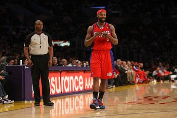 LOS ANGELES, CA - JANUARY 15:  Baron Davis #1 of the Los Angeles Clippers smiles on the court during the game against the Los Angeles Lakers on January 15, 2010 at Staples Center in Los Angeles, California. The Lakers won 126-86. NOTE TO USER: User expres