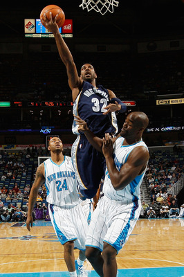 NEW ORLEANS - MARCH 03:  O.J. Mayo #32 of the Memphis Grizzlies makes a shot over Emeka Okafor #50 of the New Orleans Hornets at the New Orleans Arena on March 3, 2010 in New Orleans, Louisiana.  NOTE TO USER: User expressly acknowledges and agrees that,