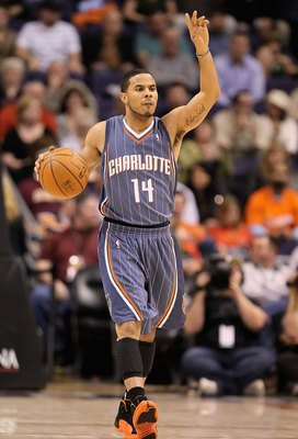 PHOENIX - JANUARY 26:  D.J. Augustin #14 of the Charlotte Bobcats handles the ball during the NBA game against the Phoenix Suns at US Airways Center on January 26, 2010 in Phoenix, Arizona. The Bobcats defeated the Suns in overtime.  114-109.  NOTE TO USE
