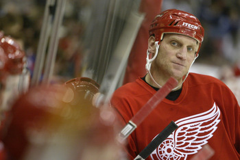DETROIT - DECEMBER 19:  Brett Hull #17 of the Detroit Red Wings looks on from the bench area during a break in game action against the Chicago Blackhawks on December 19, 2003 at Joe Louis Arena in Detroit, Michigan. The Red Wings defeated the Blackhawks 3