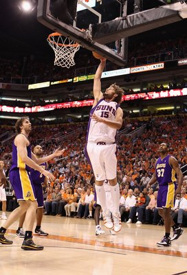 PHOENIX - MAY 25:  Robin Lopez #15 of the Phoenix Suns slam dunks during Game Four of the Western Conference finals of the 2010 NBA Playoffs against the Los Angeles Lakers at US Airways Center on May 25, 2010 in Phoenix, Arizona. The Suns defeated the Lak