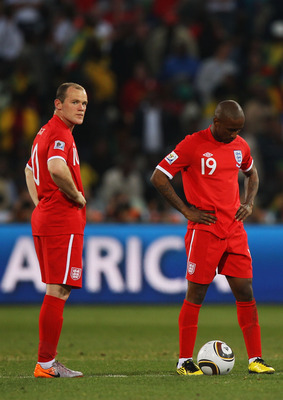 BLOEMFONTEIN, SOUTH AFRICA - JUNE 27:  Jermain Defoe and Wayne Rooney of England look on dejected after Germany score yet another goal during the 2010 FIFA World Cup South Africa Round of Sixteen match between Germany and England at Free State Stadium on