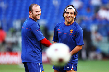 ROME - MAY 26:  Wayne Rooney and Carlos Tevez of Manchester United attend the Manchester United training session prior to UEFA Champions League Final versus Barcelona at the Stadio Olimpico on May 26, 2009 in Rome, Italy.  (Photo by Alex Livesey/Getty Ima