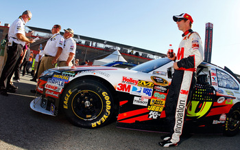 FONTANA, CA - OCTOBER 08:  Greg Biffle, driver of the #16 3M Ford, stands by his car following qualifying for the NASCAR Sprint Cup Series Pepsi Max 400 on October 8, 2010 in Fontana, California.  (Photo by Jason Smith/Getty Images for NASCAR)