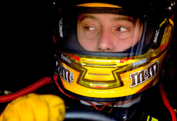 CONCORD, NC - OCTOBER 15:  Kyle Busch, driver of the #18 M&M's Toyota, sits in his car prior to practice for the NASCAR Sprint Cup Series Bank of America 500 at Charlotte Motor Speedway on October 15, 2010 in Concord, North Carolina.  (Photo by Rusty Jarr