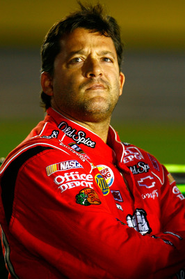 CONCORD, NC - OCTOBER 14:  Tony Stewart, driver of the #14 Office Depot/Old Spice Chevrolet, stands on the grid during qualifying for the NASCAR Sprint Cup Series Bank of America 500 at Charlotte Motor Speedway on October 14, 2010 in Concord, North Caroli