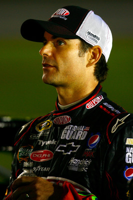 CONCORD, NC - OCTOBER 14: Jeff Gordon, driver of the #24 DuPont Chevrolet, stands on the grid during qualifying for the NASCAR Sprint Cup Series Bank of America 500 at Charlotte Motor Speedway on October 14, 2010 in Concord, North Carolina.  (Photo by Jas