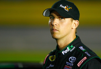 CONCORD, NC - OCTOBER 14:  Denny Hamlin, driver of the #11 FedEx Ground Toyota, stands on pit road during qualifying for the NASCAR Sprint Cup Series Bank of America 500 at Charlotte Motor Speedway on October 14, 2010 in Concord, North Carolina.  (Photo b