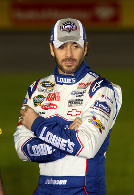 CONCORD, NC - OCTOBER 14:  Jimmie Johnson, driver of the #48 Lowe's Chevrolet, stands on the grid during qualifying for the NASCAR Sprint Cup Series Bank of America 500 at Charlotte Motor Speedway on October 14, 2010 in Concord, North Carolina.  (Photo by