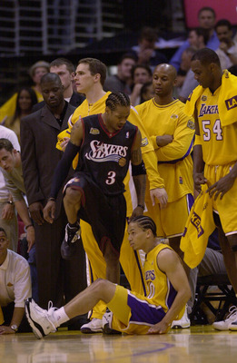 6 Jun 2001:  Allen Iverson #3 of the Philadelphia 76ers steps over Tyronn Lue #10 of the Los Angeles Lakers in game one of the NBA Finals at Staples Center in Los Angeles, California.  The 76ers won 107-101.  DIGITAL IMAGE.  Mandatory Credit: Otto Greule/
