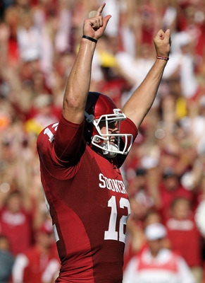 DALLAS - OCTOBER 02:  Quarterback Landry Jones #12 of the Oklahoma Sooners celebrates a touchdown against the Texas Longhorns in the second quarter at the Cotton Bowl on October 2, 2010 in Dallas, Texas.  (Photo by Ronald Martinez/Getty Images)
