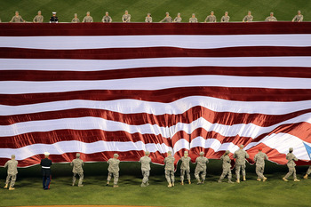 PHILADELPHIA - OCTOBER 16:  The American flag is displayed in the outfield during the singing of the national anthem before Game One of the NLCS during the 2010 MLB Playoffs between the San Francisco Giants and the Philadelphia Phillies at Citizens Bank P