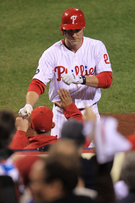 PHILADELPHIA - OCTOBER 17:  Chase Utley #26 of the Philadelphia Phillies celebrates being walked home for the Phillies' first run in the first inning against the San Francisco Giants in Game Two of the NLCS during the 2010 MLB Playoffs at Citizens Bank Pa